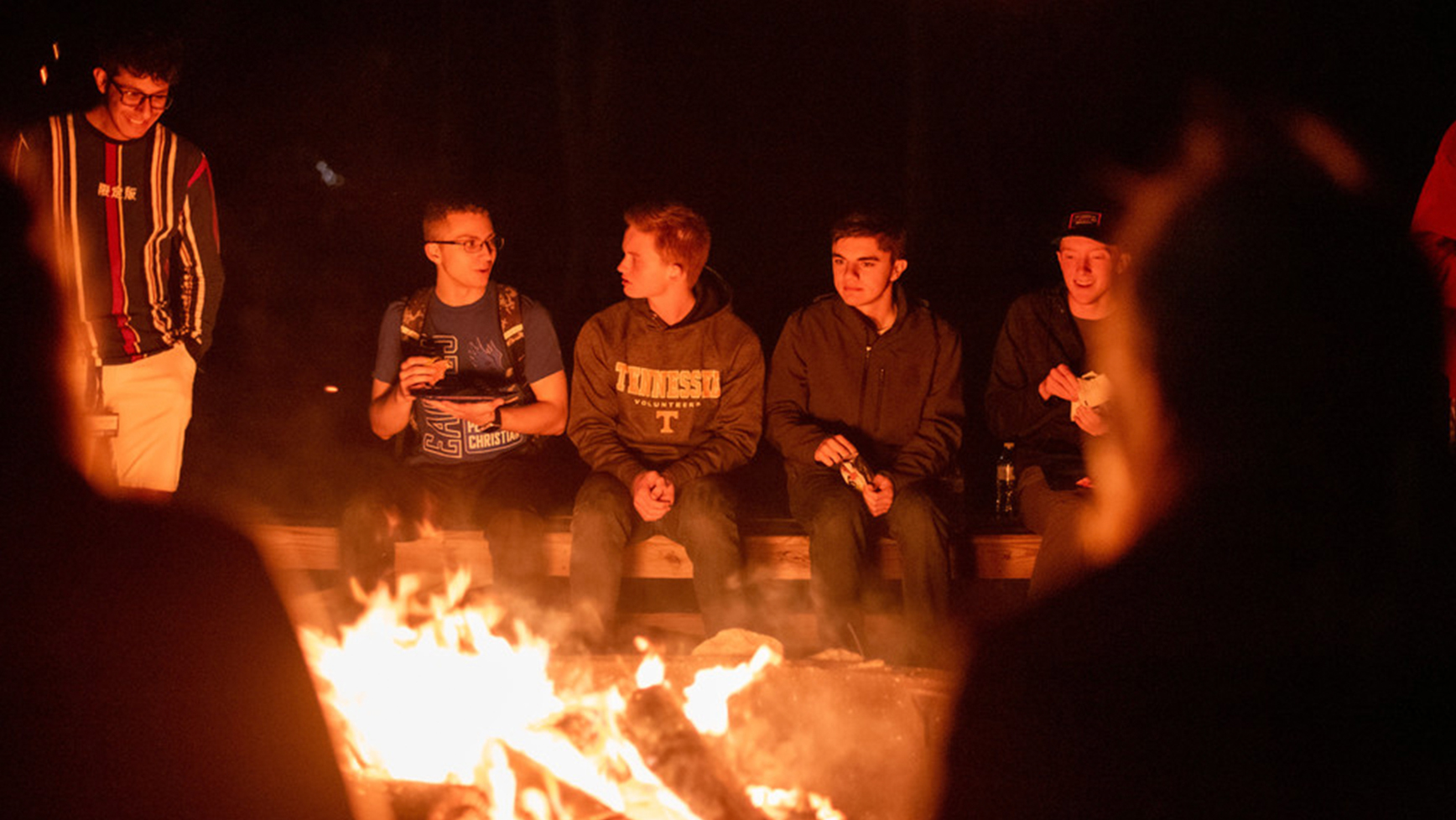 Fireside photo of students talking